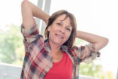 Portrait of relaxed mature woman stock image