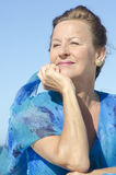Portrait relaxed mature woman  sky Stock Photos