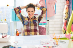 Portrait of relaxed seamstress in studio Royalty Free Stock Images
