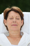 Portrait of relaxed senior woman Royalty Free Stock Image