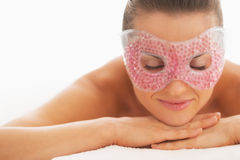 Portrait of relaxed woman in eye mask laying on massage table stock photos