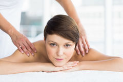 Portrait of relaxed woman receiving massage Stock Photos