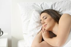 Portrait of a woman sleeping on a bed. Portrait of a relaxed woman sleeping on a bed Royalty Free Stock Images