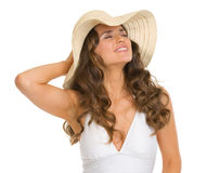 Portrait of relaxed woman in swimsuit and hat Royalty Free Stock Images
