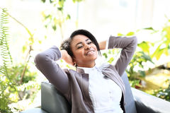 Portrait of a relaxed young businesswoman Stock Images