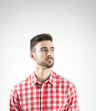 Portrait of relaxed young man in plaid shirt looking away Stock Images