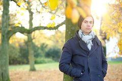 Portrait of a relaxed young man standing alone outside Royalty Free Stock Images