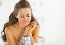 Portrait of relaxed young woman in bathroom Royalty Free Stock Photography