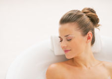 Portrait of relaxed young woman in bathtub Royalty Free Stock Photo
