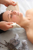 Portrait of relaxed young woman getting spa procedure Royalty Free Stock Images
