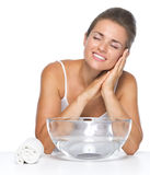 Portrait of relaxed young woman with glass bowl with water Stock Images