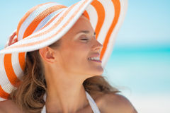 Portrait of relaxed young woman in hat on beach Stock Images