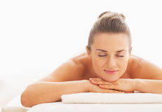 Portrait of relaxed young woman laying on massage table Royalty Free Stock Photography
