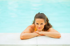 Portrait of relaxed young woman in swimming pool Royalty Free Stock Images