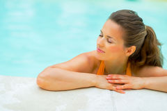 Portrait of relaxed young woman in swimming pool Stock Photo