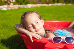 Portrait of relaxing adorable little girl enjoying Stock Images