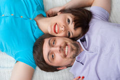 Portrait of relaxing couple in bed Royalty Free Stock Images