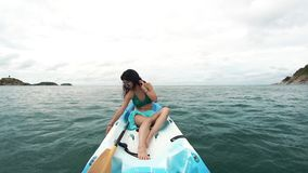 Portrait of a relaxing girl in kayak. Portrait of a girl in kayak stock video