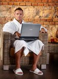Portrait of relaxing man with laptop Stock Photography