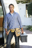 Portrait Of Repairman Arriving In Van Stock Photo