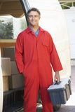 Portrait Of Repairman Arriving In Van Royalty Free Stock Photo