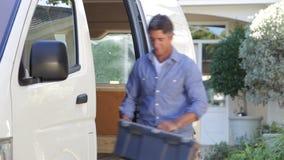 Portrait Of Repairman Arriving In Van stock footage