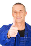 Portrait of repairman showing thumbs up Royalty Free Stock Photo