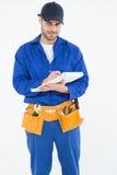 Portrait of repairman writing on document Royalty Free Stock Photo
