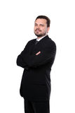 Portrait of a representative business man. Portrait of a representative smiling business man standing with crossed arms royalty free stock photography