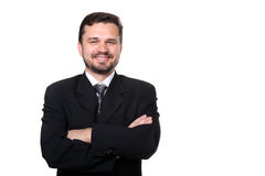 Portrait of a representative business man. Portrait of a confident mature Caucasian business man with hands folded on white background royalty free stock image
