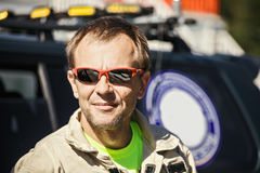Portrait of rescuer at car Stock Images