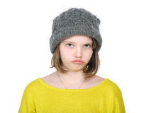 Portrait of resentful teenager in funny hat knitted jumper and b Stock Photography