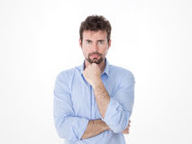 Portrait of resolute man with fist on chin Stock Images