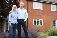 Portrait Of Retired Couple Standing Outside Home. Retired Couple Standing Outside Home Royalty Free Stock Image