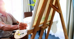Portrait of retired person in wheel chair painting
