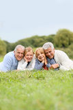 Portrait of retired seniors lying in grass smiling Royalty Free Stock Photography