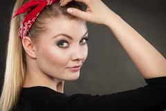 Portrait of retro pin up girl in red handkerchief. Retro and vintage style. Old fashion. Portrait of lovely pretty young woman in pin up hairstyle with red Royalty Free Stock Photo