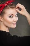 Portrait of retro pin up girl in red handkerchief. Stock Photo