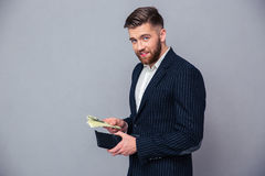 Portrait of a rich businessman holding money Stock Photography