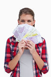 Portrait of a rich woman holding bank notes Royalty Free Stock Photo