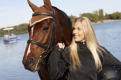 Portrait of rider and horse. Outdoor portrait of young female rider and horse Stock Image