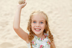 Portrait risible blonde girl with pigtails and blue round eyes.  Stock Image