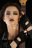 Portrait of a rock star wearing glamorous make up Stock Images