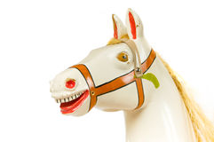 Portrait of a rocking horse. Old antique rocking horse made of wood Royalty Free Stock Photo