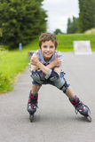 Portrait  rollerskater in protection kit. Portrait of smiling rollerskater in protection kit Royalty Free Stock Photo