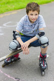 Portrait of rollerskater in protection kit. Portrait of smiling rollerskater in protection kit Stock Image