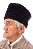 Portrait of a romanian old peasant with old fashion Astrakhan ha Royalty Free Stock Images