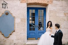 Portrait of a romantic beautiful couple traveler walking in the. Bride and groom walking through the old town Stock Image