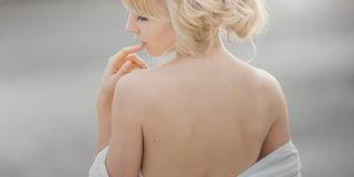 Portrait of romantic blond woman white dress Stock Photos