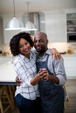 Portrait of romantic couple dancing in kitchen Royalty Free Stock Image